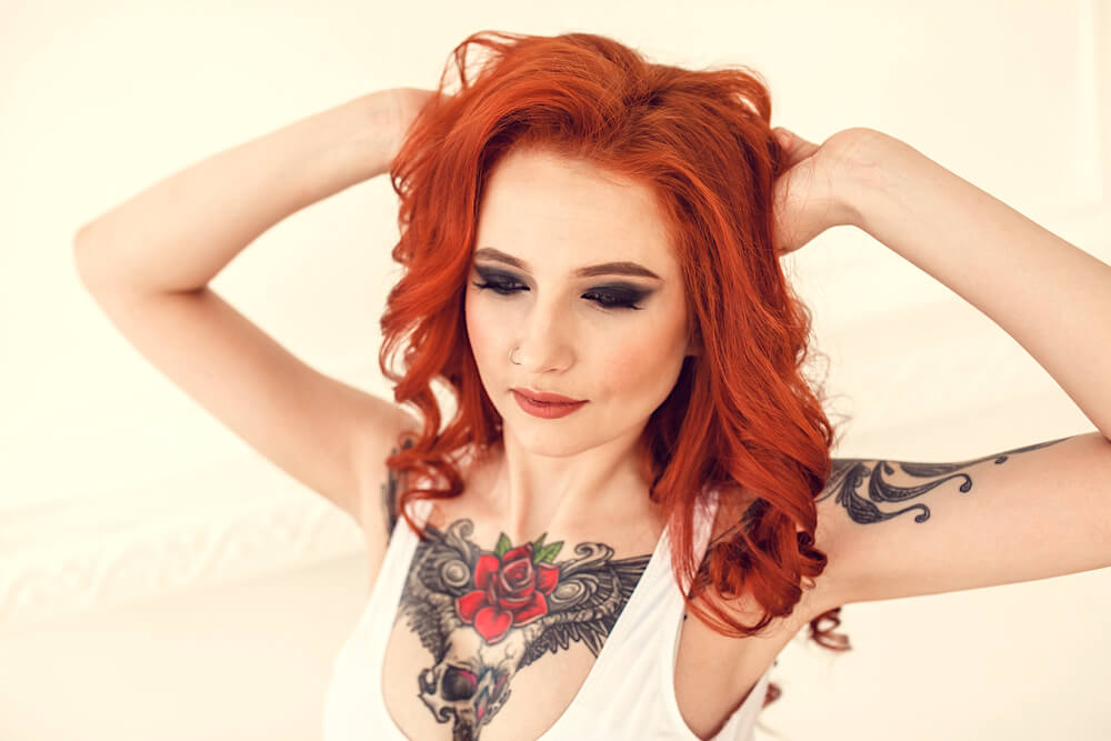 Young red-headed woman with tattoos